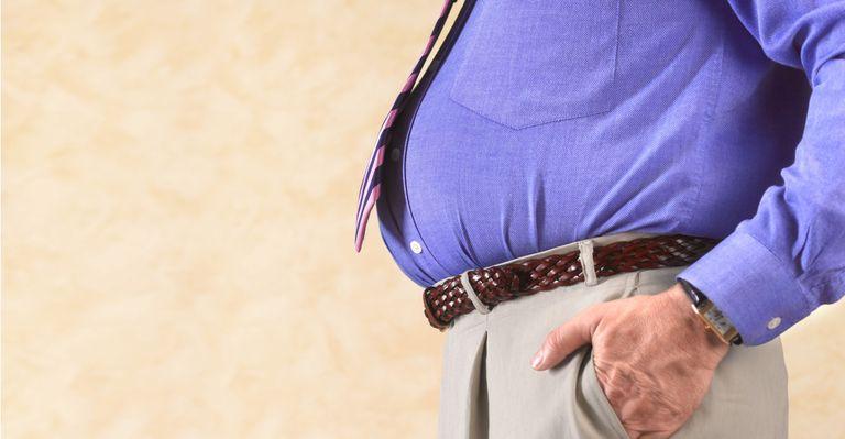 Indice de masse corporelle peut aider à prédire la probabilité d'infection .. Peter dazeley / Getty Images